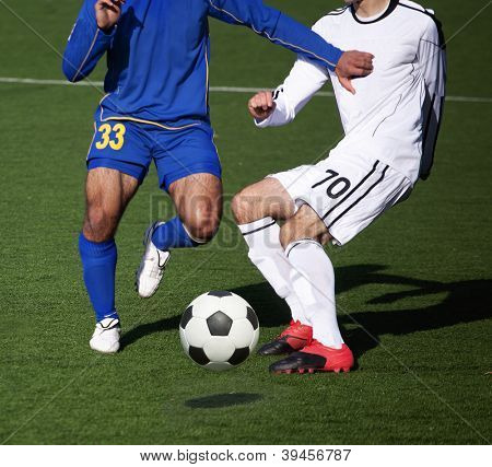 intense struggle for the ball on the soccer field