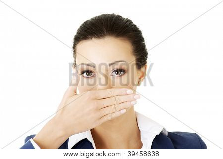 Portrait of young business woman covering with hand her mouth, isolated on white background