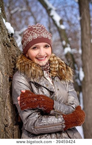 Portrait Of Smiling Young Woman In A Winter Park Outdoors