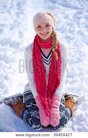 Portrait Of Girl Sitting On The Snow