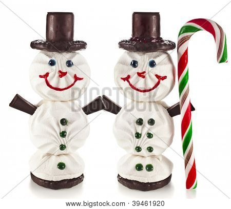 Sweet funny snowman made ??of marshmallow, chocolate, candy isolated on white background