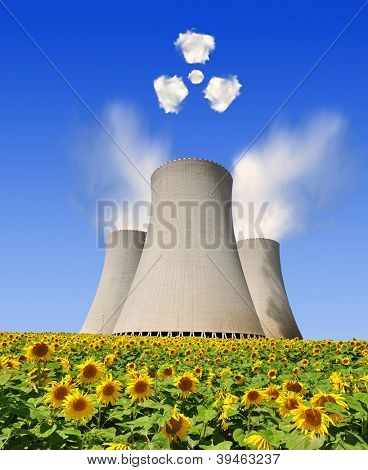 Nuclear power plant with symbol radiations from clouds