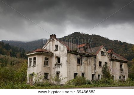 Gloomy house in the mountain forest