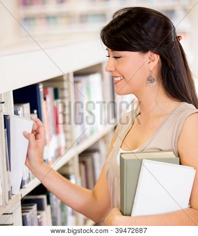 Woman at the library looking for a book
