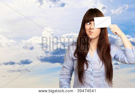 Portrait Of A Girl Holding Paper And Making Face, Outdoor