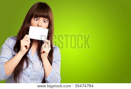Woman Holding Blank Card Isolated On Green Background