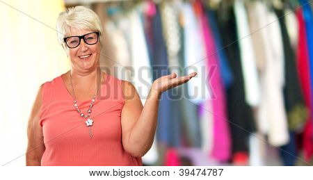 Portrait Of A Senior Woman Presenting, Indoor