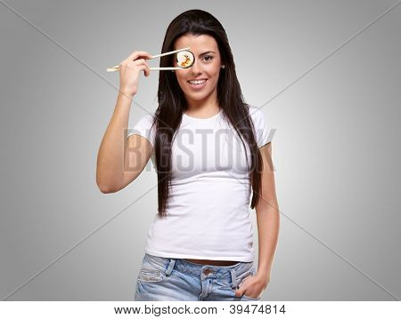 Portrait Of A Female Holding Sushi Roll On Gray Background