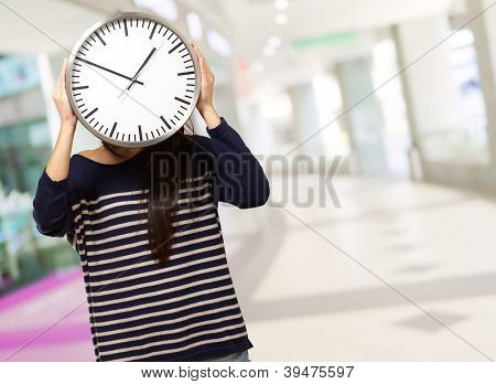 Young Girl Showing Clock And Hiding Her Face, Outdoor