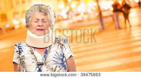 A Senior Woman Wearing A Neck brace, Outdoor