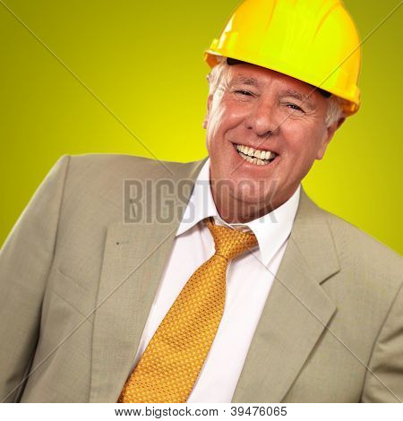 Senior Engineer Standing And Smiling On Yellow Background