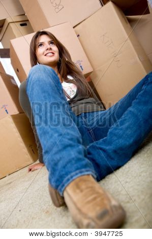 Woman With Boxes Moving Homes