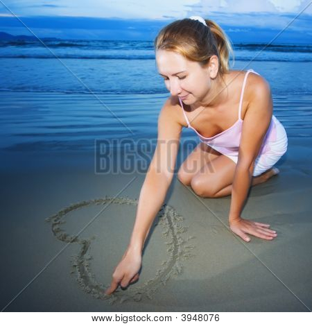 Young Woman Draws Heart