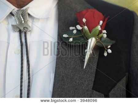 Boutonniere With Bolo Tie