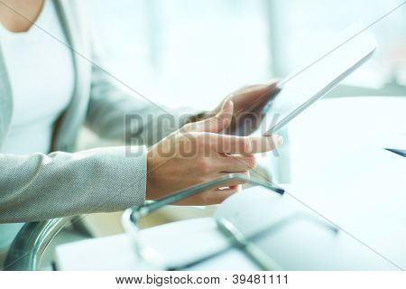Close-up of businesswoman working with digital tablet