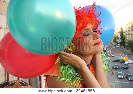 Dreaming Girl in colorful wig with balloons