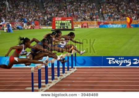 Women Racing 110M Hurdles