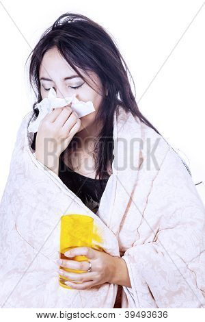 Blowing Nose With Tissue And Glass Isolated In White
