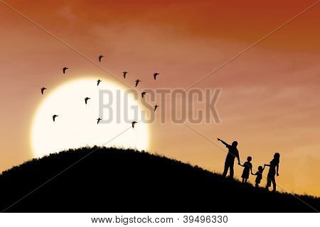 Happy Family Silhouette With Sunset Landscape
