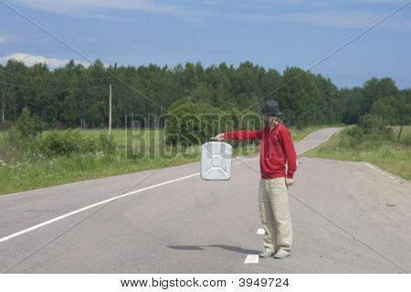 Young Man On Highway With Empty Gas Can