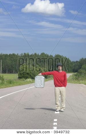 Young Man On Highway With Empty Gas Can Ii