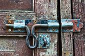 picture of outhouse  - Rusty lock on the old wooden door