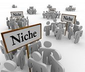 Several groups of people in niche markets gathered around signs gathering them into niches