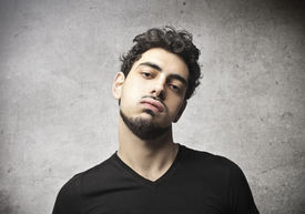 foto of snob  - Young man with an arrogant face - JPG