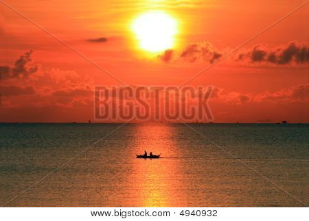 Boating At Sunrise
