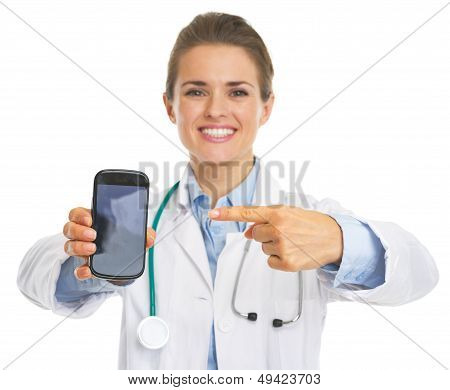 Closeup On Doctor Woman Pointing On Mobile Phone