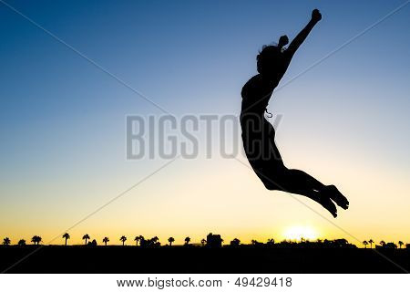 Woman Silhouette Jumping