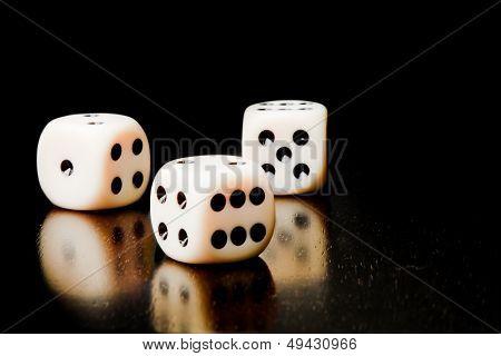 Three White Dice On Old Wood Black Table