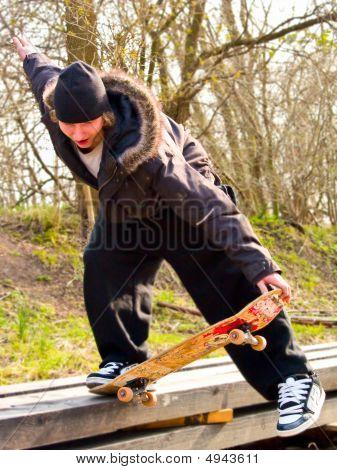 Urban Lifestyle -young Teenage Skatboarder Doing Tricks