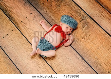 Newborn Baby Boy Wearing A Little Man Costume