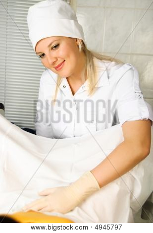 Gynecologist Examining A Patient