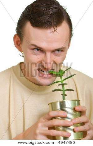 Man Tries To Eat A Young Plant
