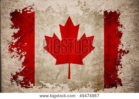 Canada Flag On Old Vintage Paper Background Concept