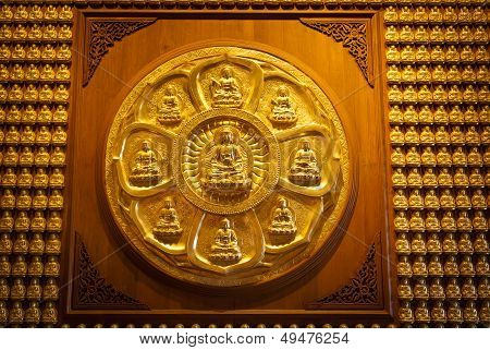 Golden Chinese Buddha Statue On Wood