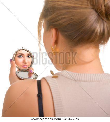 Women Looks In A Mirror