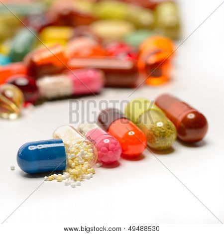 various pills isolated on white