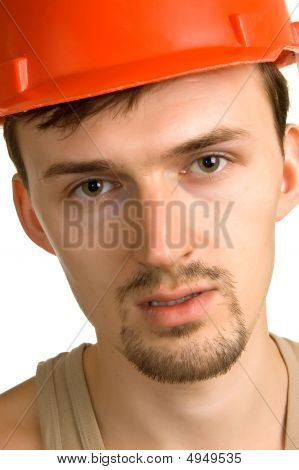 Young Worker In A Red Building Helmet