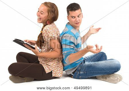 Young Girl And Boy With Tablet
