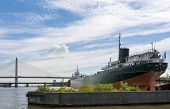 picture of skyway bridge  - A cargo ship docked at the port of Toledo with the Veterans - JPG