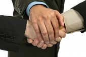 foto of joining hands  - close up of three men hands together in a deal studio picture - JPG