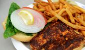picture of mahi  - blackened fish sandwich with lettuce tomato and onion - JPG