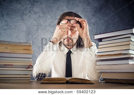 Exhausted Man Reading Books