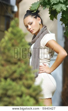 Attractive Young Woman In Autumnal City