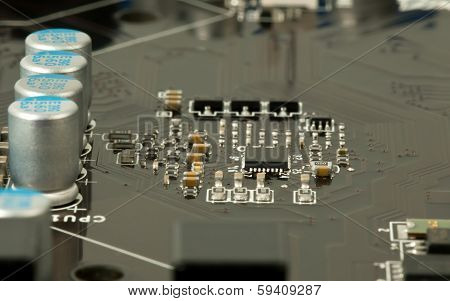 Laptop Microchip And Conductors On Mother Board Closeup