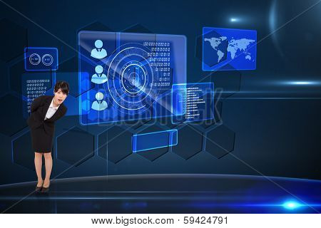 Surpised businesswoman bending against futuristic technology interface