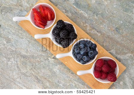 Dishes Of Fresh Berries Arranged Diagonally